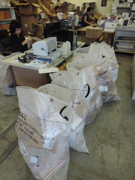 Betty has been a busy bee processing all these packages for shipping out.